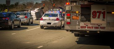 Carrboro NC, /US-March 10 2017:Fire truck, police car and overturned logging truck stock image