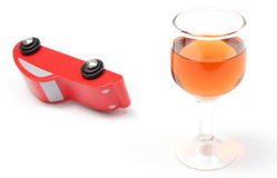 Overturned model vehicle and glass of wine Stock Images