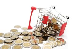 Overturned red miniature shopping cart filled with new 10 Thai Baht coins. royalty free stock photos
