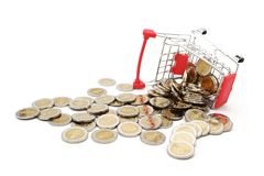 Overturned red miniature shopping cart filled with new 10 Thai Baht coins. royalty free stock photography