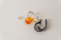 Overturned single malt whiskey glass, on white, with gold chain Royalty Free Stock Image