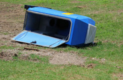 Overturned toilet. Blue open overturned portable toilet royalty free stock photo