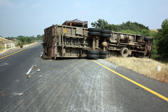 Overturned Truck. A view of an overturned truck on an highway in an accident Stock Image