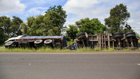 Overturned truck accident on highway road Stock Images