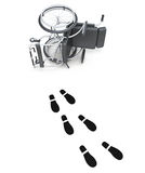Overturned wheelchair and footprints on white background.  Stock Photo