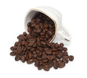 Overturning cup and grain coffee Stock Photos
