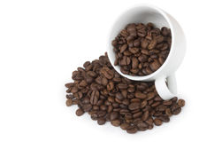 Overturning cup with scattered grain coffee Stock Images