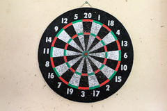 Overused Dartboard. A very worn in dartboard with holes surrounding where people missed Royalty Free Stock Photo