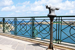 Overview. Telescope in a public area with beautiful overview over the grand harbour in Valletta, Malta royalty free stock photos