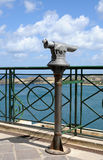 Overview. Telescope in a public area with beautiful overview over the grand harbour in Valletta, Malta stock photography
