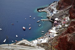 Overview of Amoudi Bay at Santorini, Greece. For beautiful views of the caldera, descend the 300 steps from the northern city of Oia to the tiny port of Amoudi Stock Photo