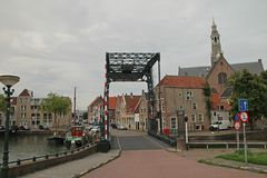 Overview of the ancient inner city of Maaassluis in the netherlands from the dike to protect flooding in the netherlands.  Stock Photos