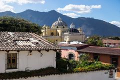 Overview of Antigua de Guatemala with mountains stock photography