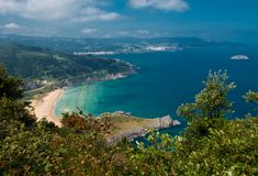 Overview of the beach of Laga and the Basque coast. Overview of the beach of Laga in the foreground and the Basque coast to Bermeo Royalty Free Stock Images