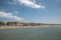 Overview of the beach and town of Ostia between the Mediterranean sea and sunny sky. Royalty Free Stock Photo