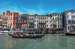 Overview of buildings, piers and gondolas in front of the Canal Grande at Venice. stock photography