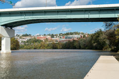 Overview of City of Morgantown WV. View of the downtown area of Morgantown WV and campus of West Virginia University from river bank stock images