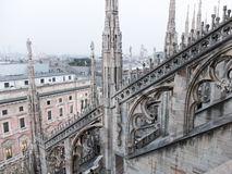 Overview of City from Roof of Milan Cathedral. High Angle Architectural Detail of Historic Milan Cathedral Church with Focus on Flying Buttresses and Italian Royalty Free Stock Images