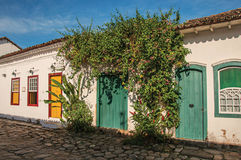 Overview of cobblestone street with old houses under blue sunny sky in Paraty. Overview of cobblestone street with old houses under blue sunny sky in Paraty, an Royalty Free Stock Photos