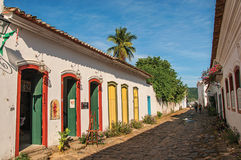Overview of cobblestone street with old houses under blue sunny sky in Paraty. Paraty, Brazil - January 25, 2015. Overview of cobblestone street with old houses Royalty Free Stock Photo