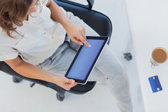 Overview of a designer using her tablet pc Royalty Free Stock Photo