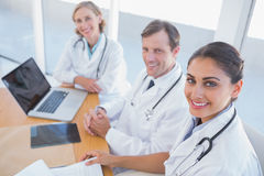Overview of doctors looking at camera Stock Images