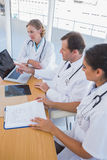 Overview of doctors working together on a laptop Royalty Free Stock Image