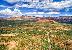 Overview of Dry Creek road in Sedona, USA. Overview of Dry Creek road and Boynton Canyon Pass in Sedona with red rock formations on the background Stock Photography