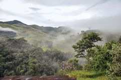 Overview of Forest and hills shrouded by mist and clouds near the town of Joanópolis. Stock Image