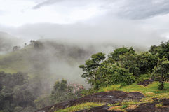 Overview of Forest and hills shrouded by mist and clouds near the town of Joanópolis. Stock Photos