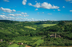 Overview of green hills, vineyards, forests and towered stronghold near Orvieto. Royalty Free Stock Photo