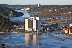 Overview, Halden port. Picture shows held port and grain silo. In the background seems to Nexans cable tower 120 meters above sea level Stock Photo