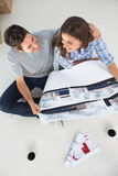 Overview of a husband and his wife holding house plan Stock Photography