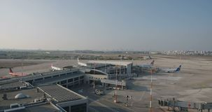 Overview of a large airport with planes and terminals. Overview of a large airport terminal with planes stock video footage