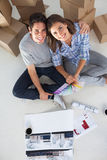 Overview of a man and his wife holding house plans Royalty Free Stock Photos