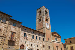 Overview of old buildings and bell tower with clock at Colle di Val d`Elsa. Stock Photo