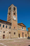 Overview of old buildings and bell tower with clock at Colle di Val d`Elsa. Stock Image
