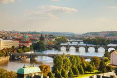 Overview of old Prague with Charles bridge. At sunset royalty free stock photo