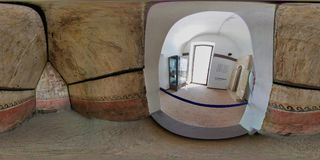 360 overview of the painted tomb. Baia, Naples, Campania, Italy - June 16, 2018: Spherical photo of the painted tomb on display at the Archaeological Museum of Stock Photography