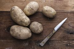 Overview of potatoes and a knife royalty free stock image