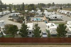 An overview of Recreational Vehicles and trailers parked in a trailer camp outside of Bakersfield, CA royalty free stock photos