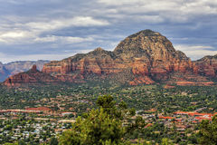 Overview of  Sedona, Arizona, USA. Overview of Sedona, view to Capital Butte Mountains from the Airport Overlook place. Dramatic afternoon sky just before heavy Royalty Free Stock Image