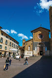 Overview of a square with old buildings, church and people under a blue sky in Orvieto. Royalty Free Stock Photography