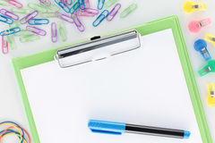 Overview Stationery Green Clipboard and Pen Stock Images