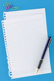 Overview Stationery Notepaper on Blue. Overview of notepaper on blue background with pen Royalty Free Stock Photos