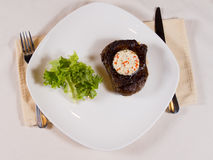 Overview of Steak with Herbed Butter on Plate Royalty Free Stock Images