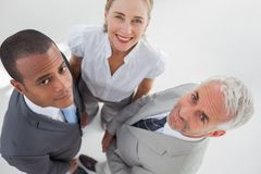 Overview of three business people standing close to each other Royalty Free Stock Images