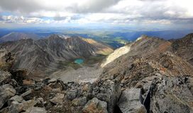 Overview from the top of Munku-Sardyk at the lake Ehoy. Viewpoint - the main peak of the mountain massif of the Eastern Sayan - Munku-Sardyk altitude 3491 m Stock Photos