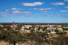 Overview of the town of Kalgoorlie, Western Australia. Looking out across the outback mining town of Kalgoorlie, Western Australia. There are trees in the stock photo
