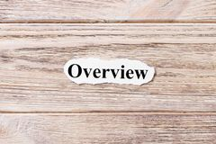 OVERVIEW of the word on paper. concept. Words of OVERVIEW on a wooden background royalty free stock photos